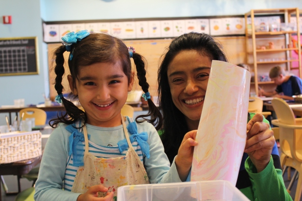 Image from Mad Science Month of a mother and daughter enjoying Painting with Science programming in the Kraft Artabounds Studio.